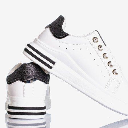 Білі та чорні спортивні кросівки з блискучими вставками Solesca - Взуття
