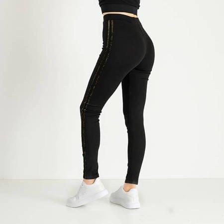 Жіночі чорні гетри з золотими смужками - Одяг